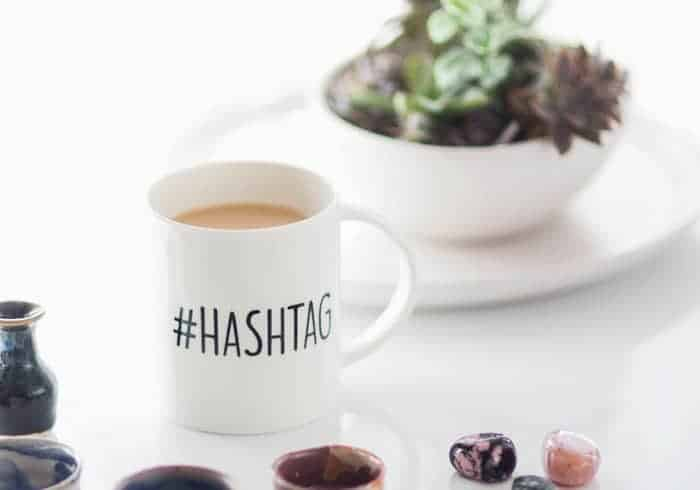 A mug that says #hashtag.