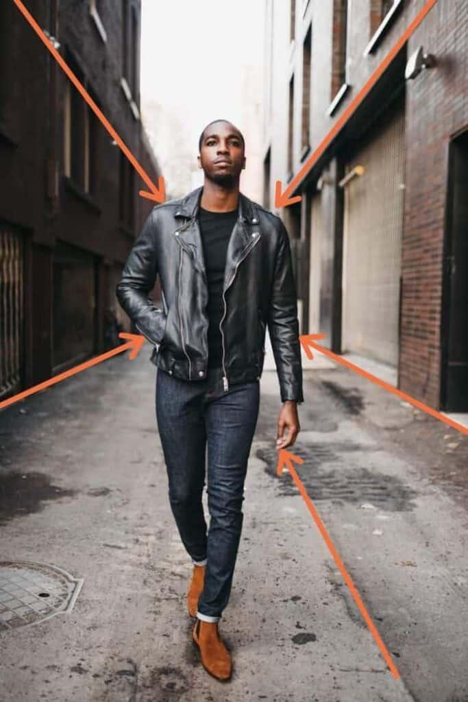 A man walking down an alley.