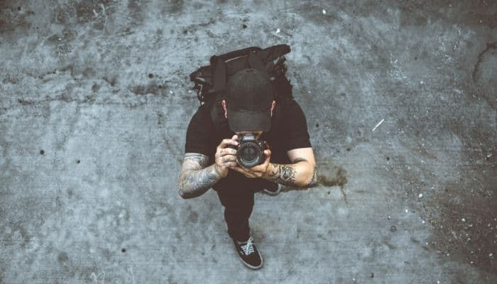 Top down image of a man holding a camera.