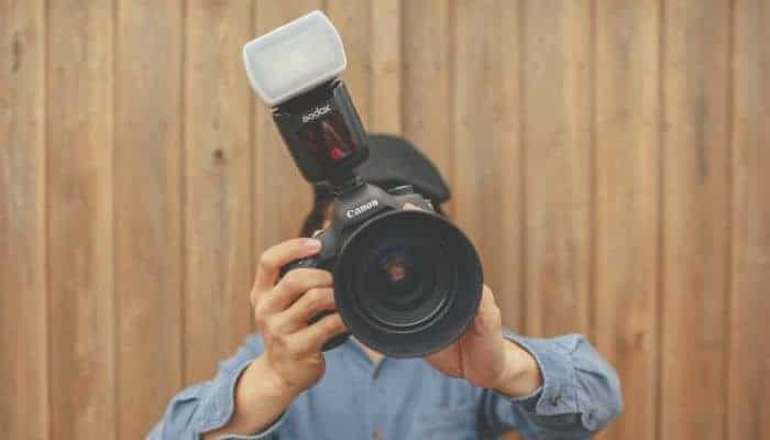 Person holding a camera.