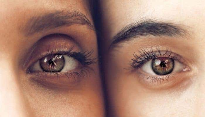 Close-up of eyes from two different people.