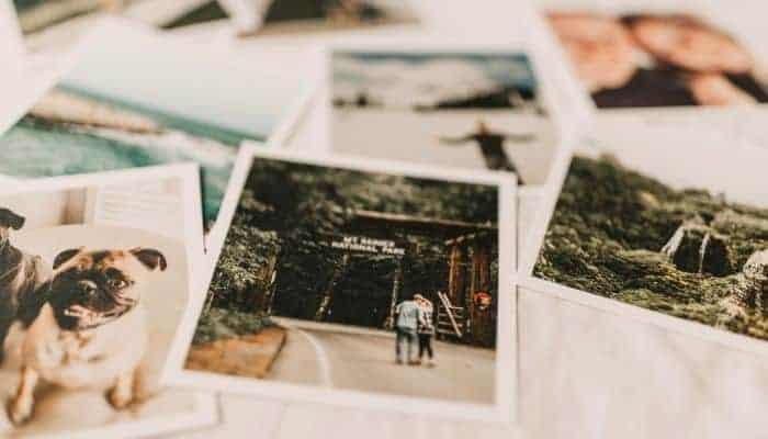 Polaroid photos on white textile.