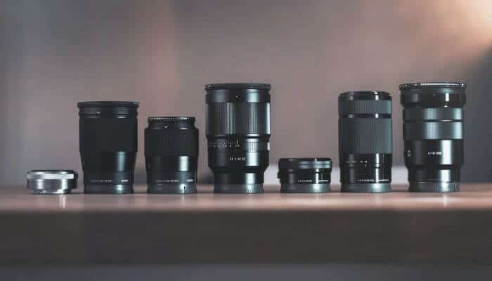 A line of camera lenses.