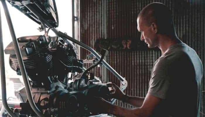 Mechanic working on an engine.