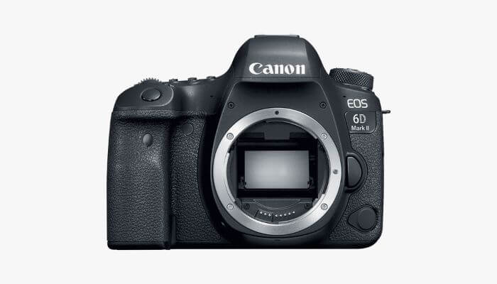 Black Canon DSLR camera body without a lens.