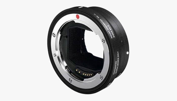 Black lens adapter by Sigma.