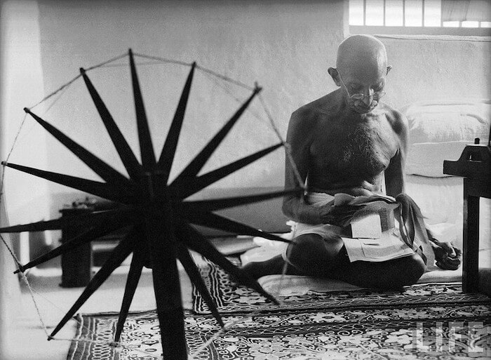 Grayscale portrait of Gandhi.