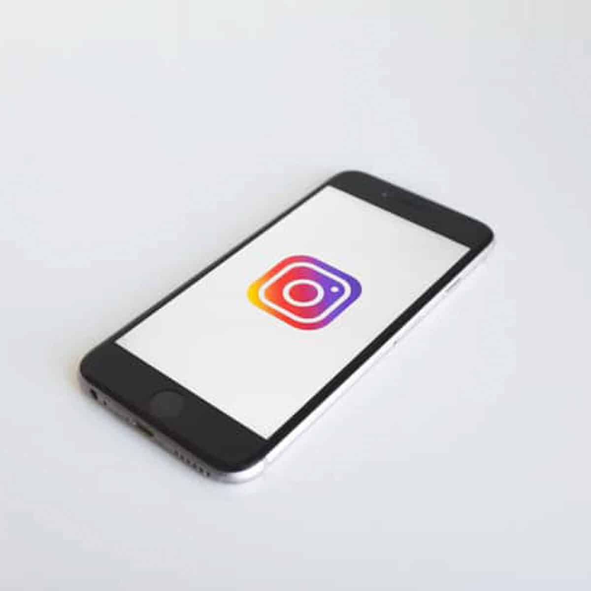A phone showing the Instagram logo.
