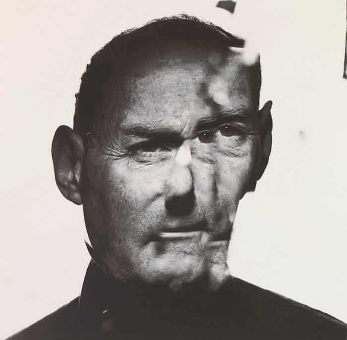 Reflection of Irving Penn in a cracked mirror.
