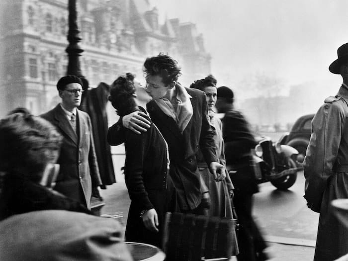 Couple kissing on the streets of Paris.
