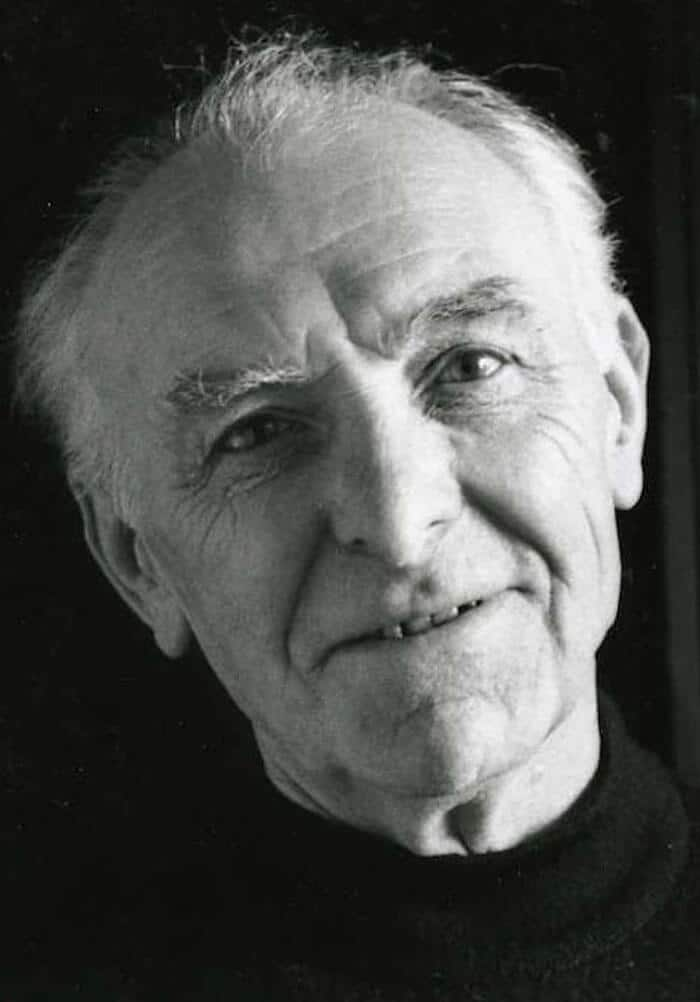 Grayscale headshot of Robert Doisneau.