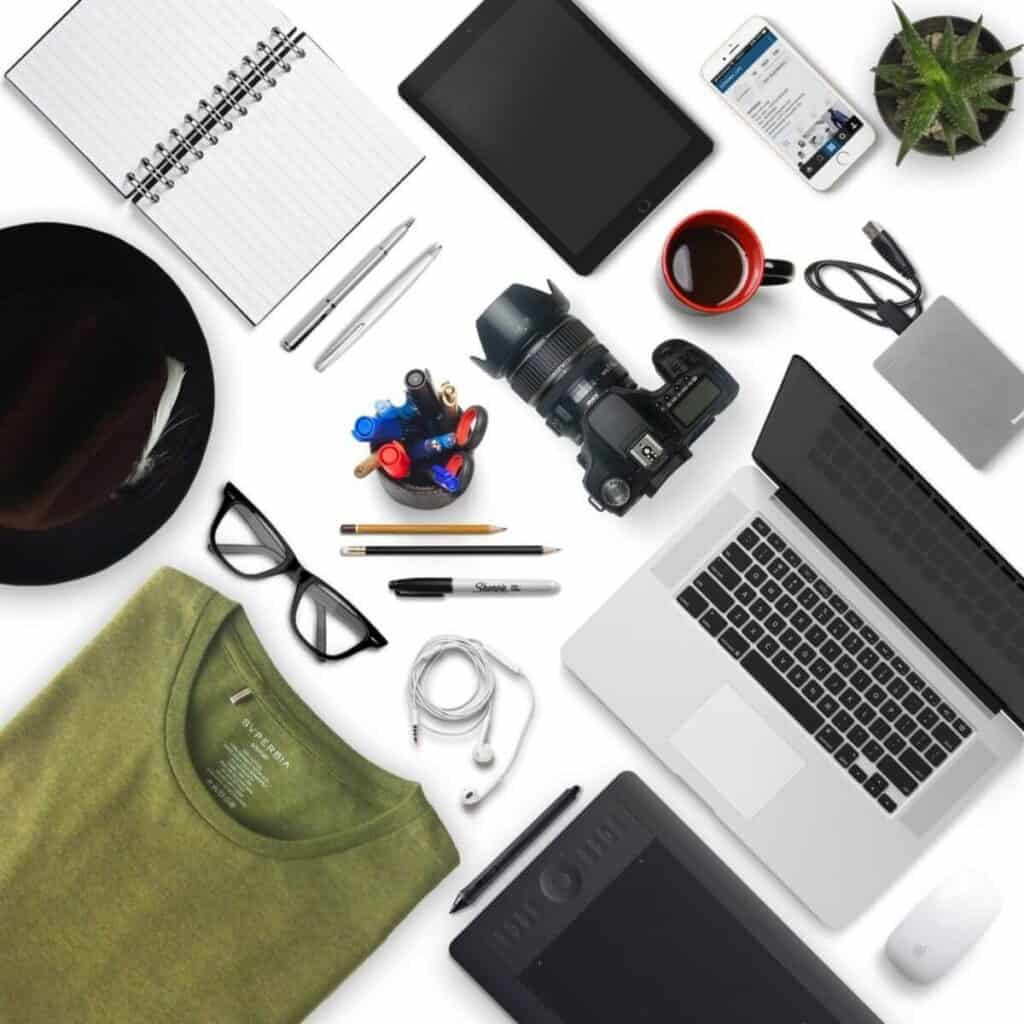 Flatlay of a photographers equipment and laptop.