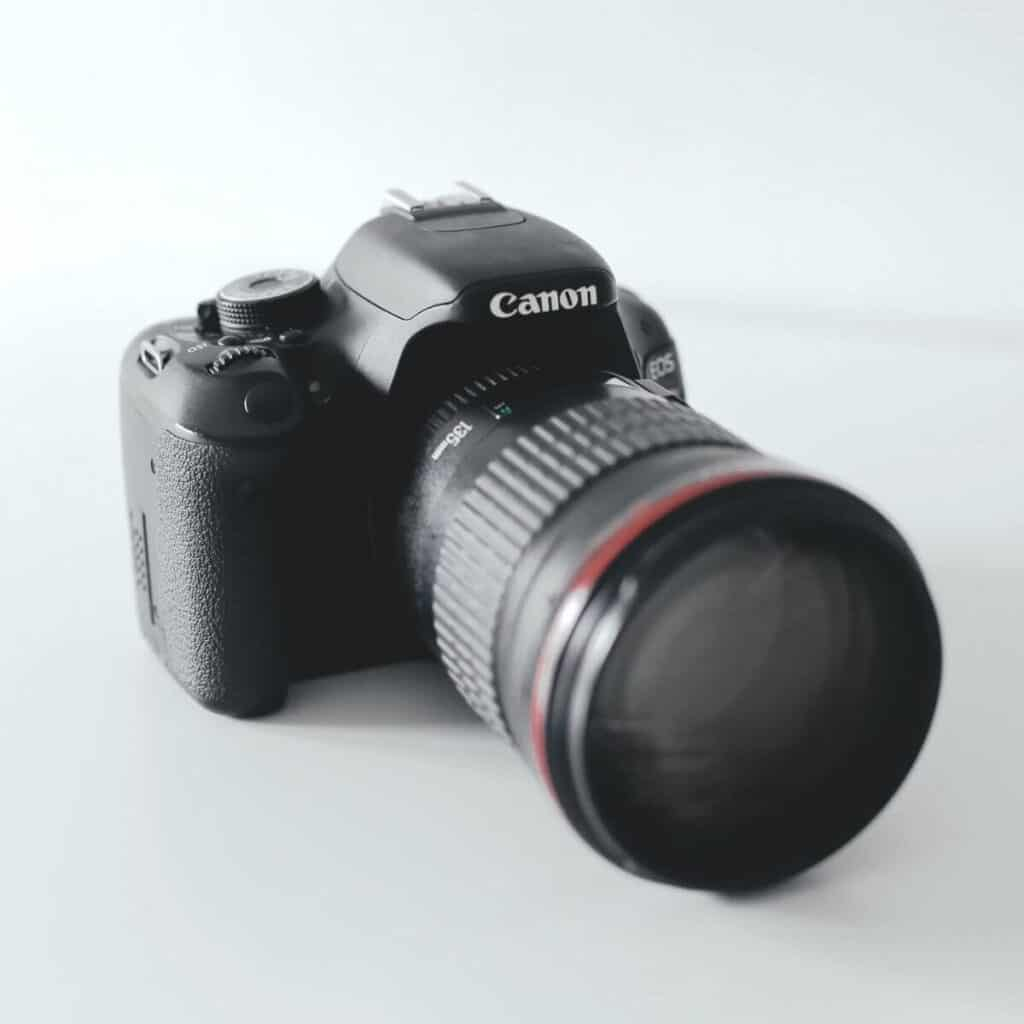 Canon camera on a white table.