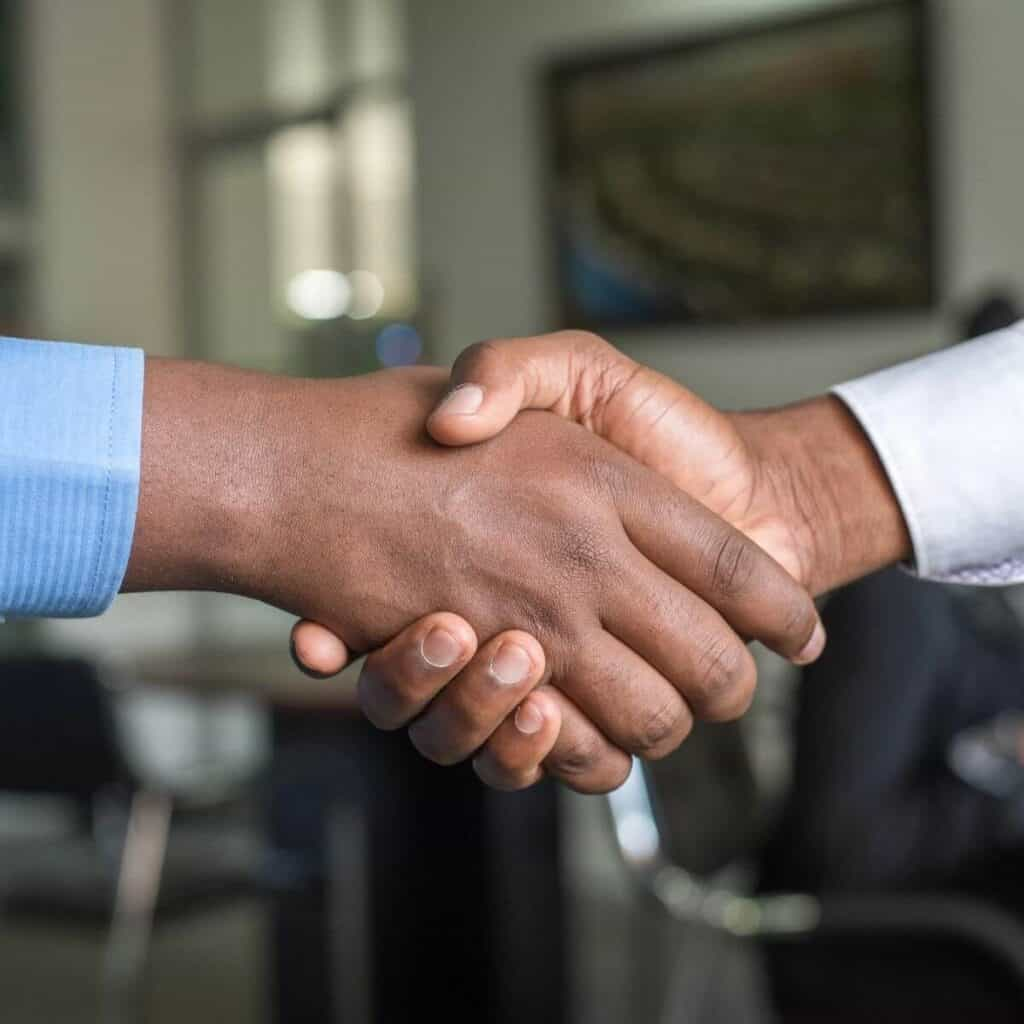 Close-up of two people shaking hands.