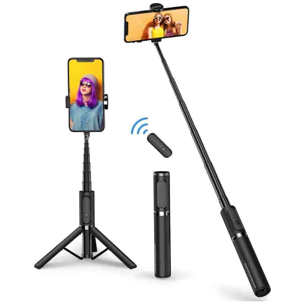 Selfie stick holding a phone that also works as a tripod and has a wireless remote.