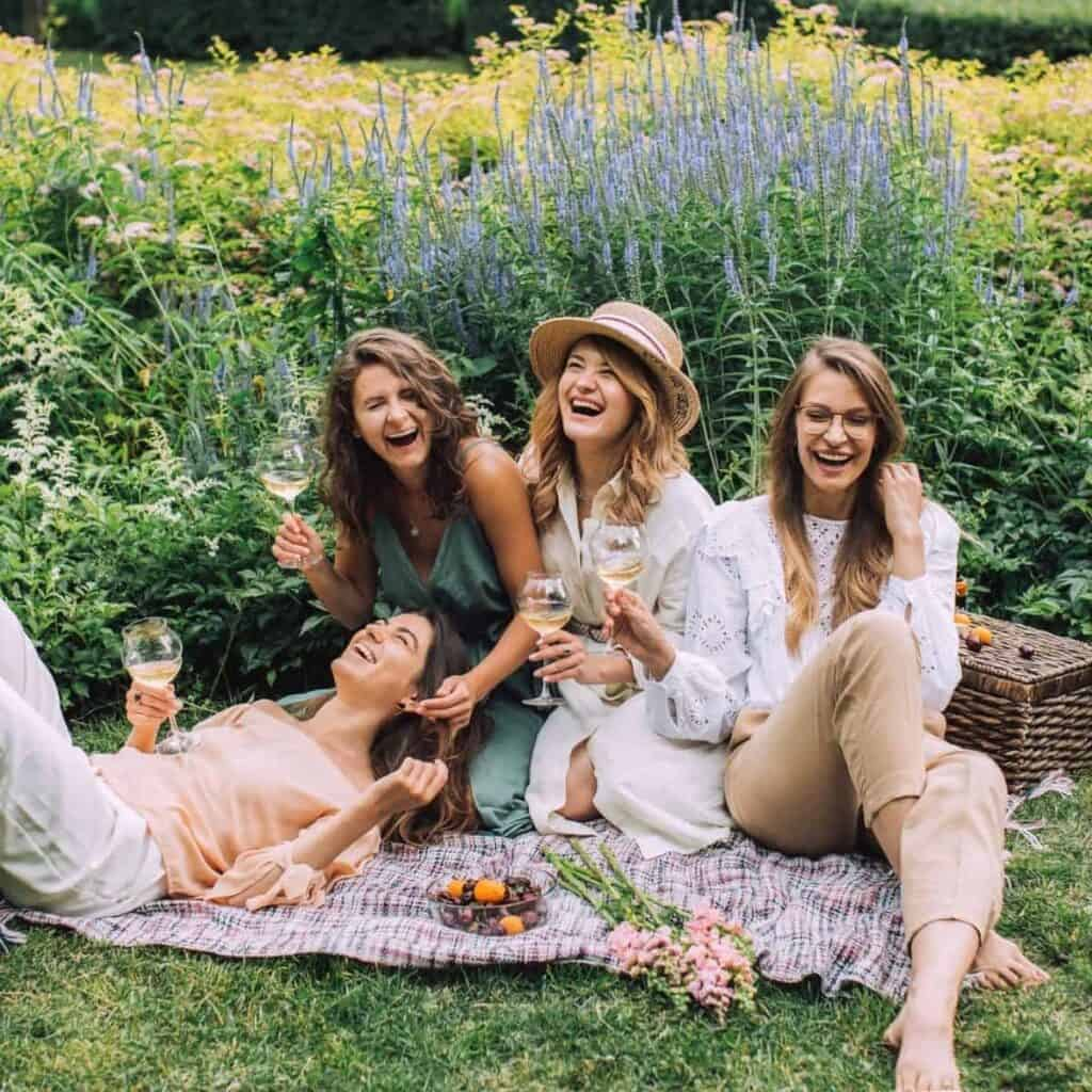 Group of friends having a picnic in a field.