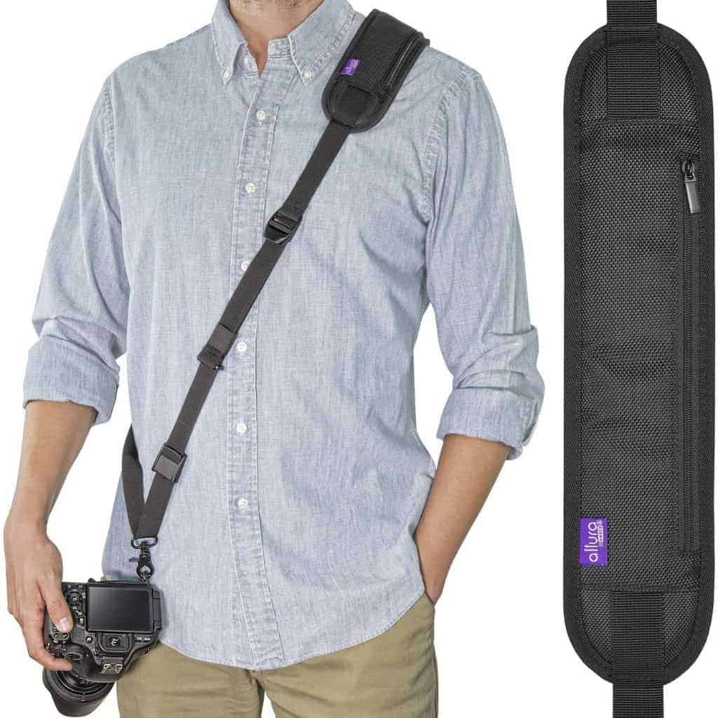 Person wearing a camera strap across their body.