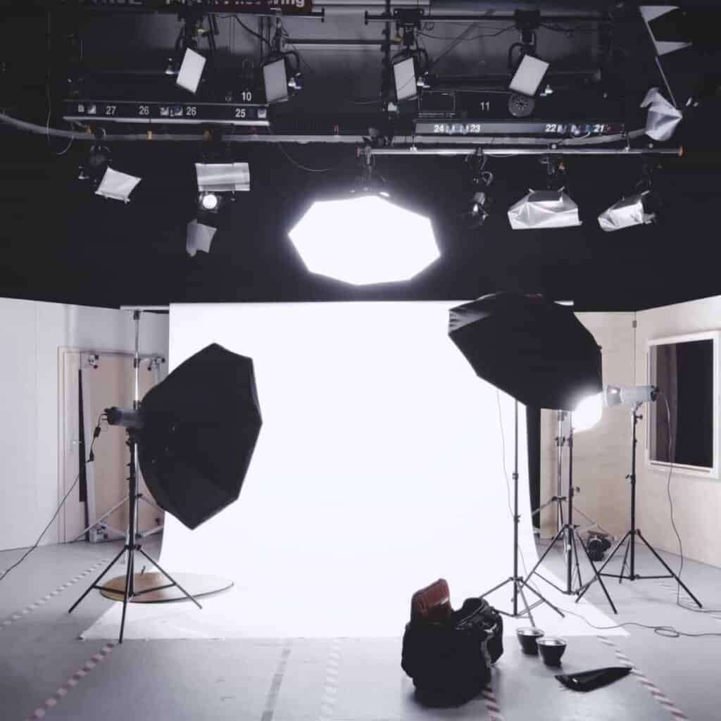 Photography studio with backdrop and lights.