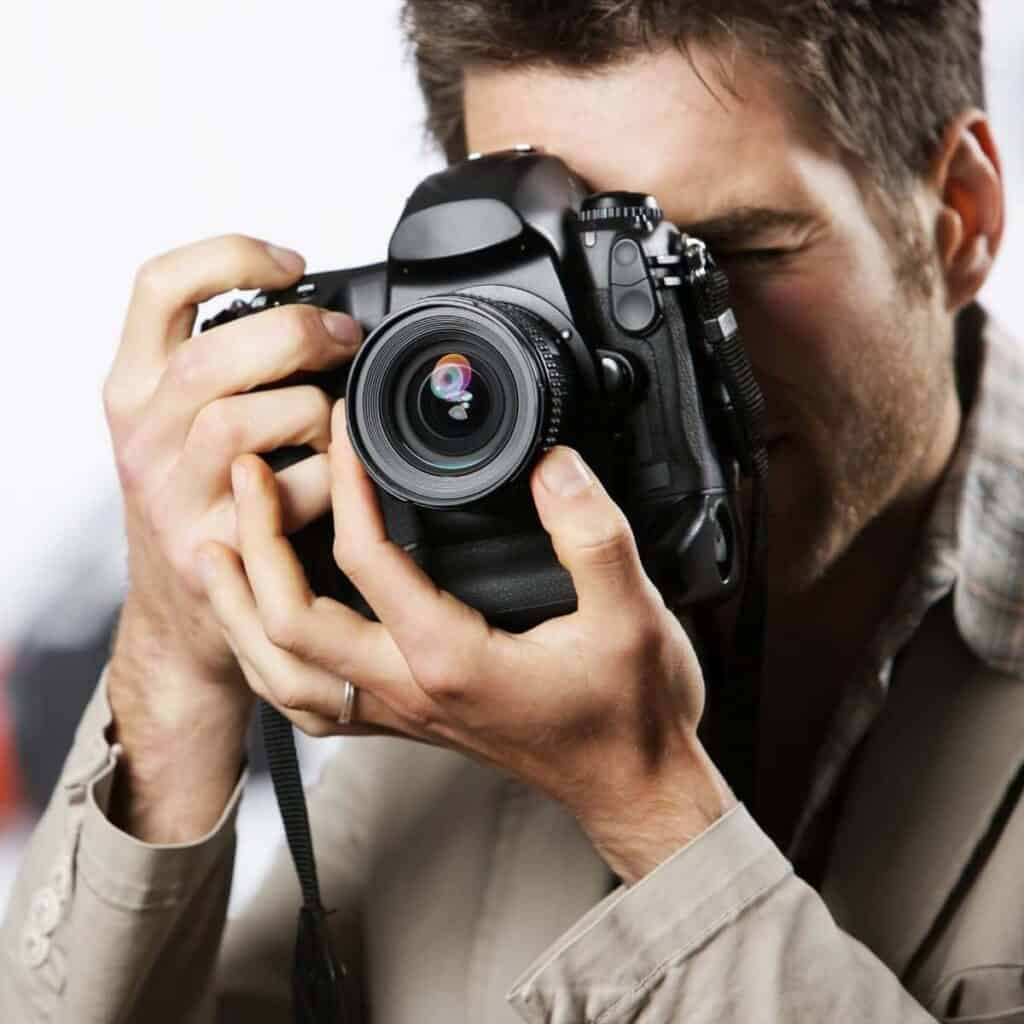 Close-up of a photographer taking a photo.